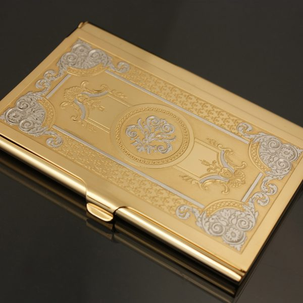 Gold business card holder decorated with hand engraving