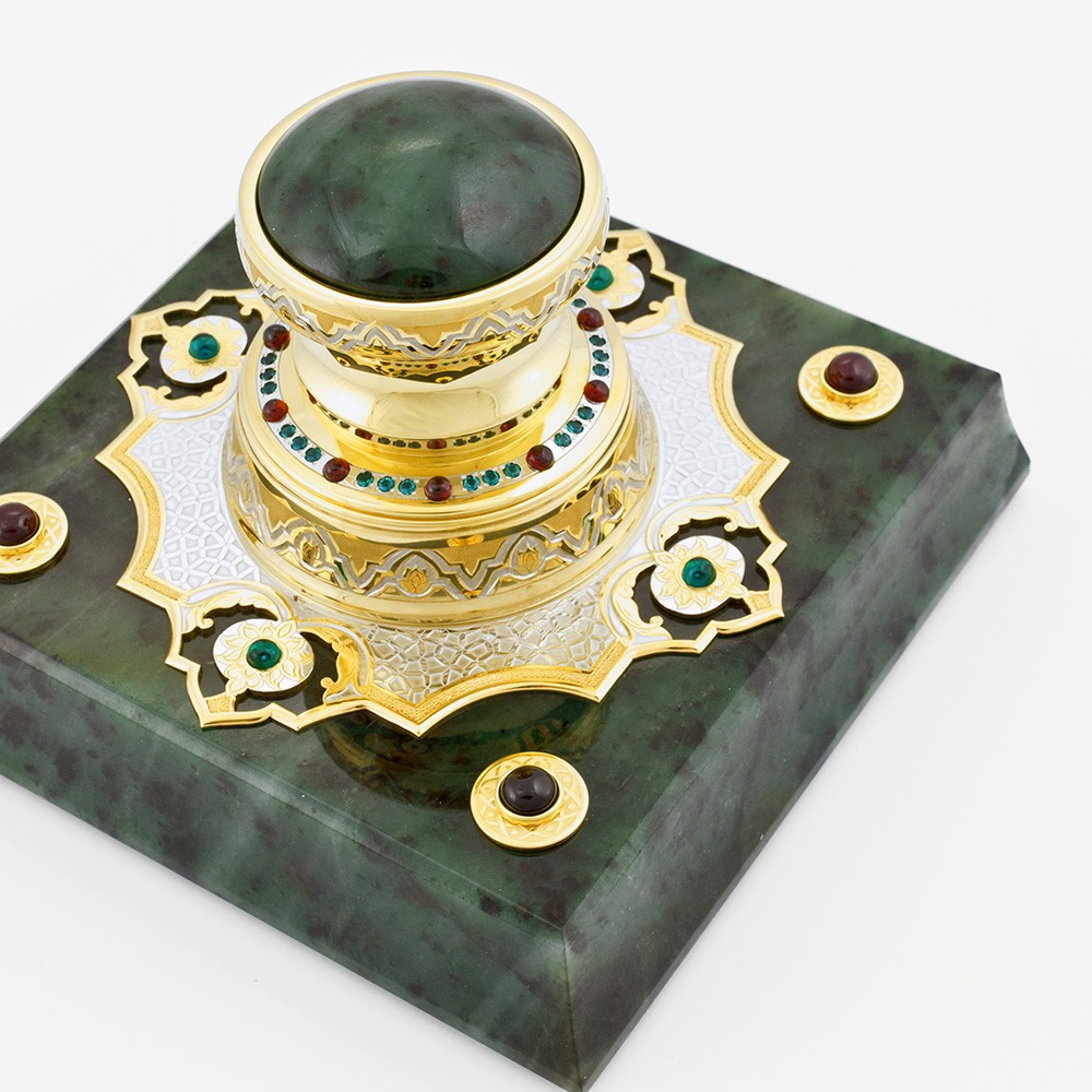 Handmade gold stamp on a jade base