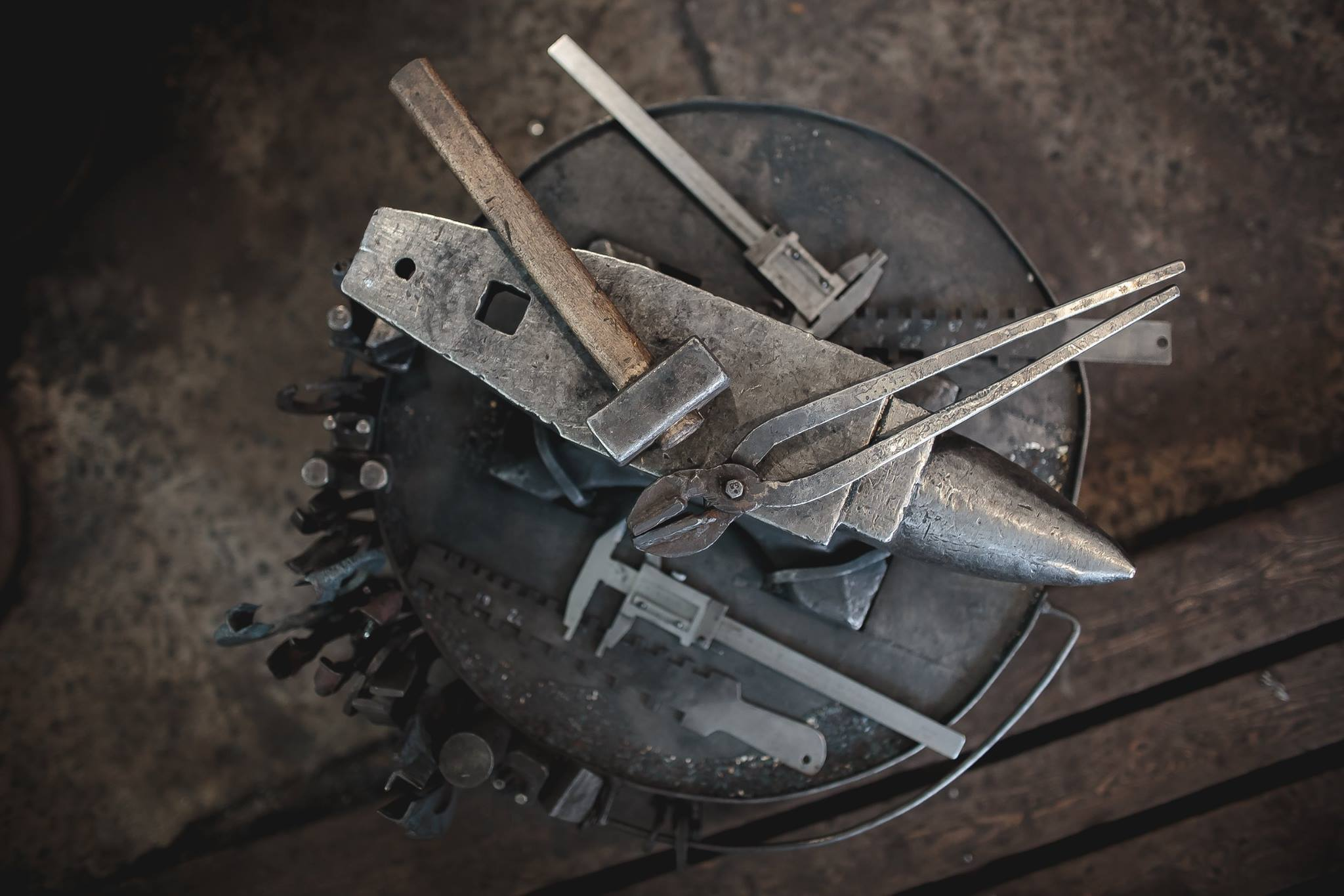 Weapon art. Image of anvil with tools