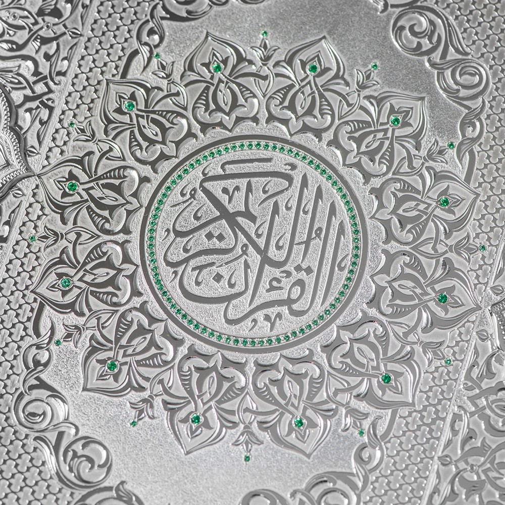 The Quran is embellished with green stones