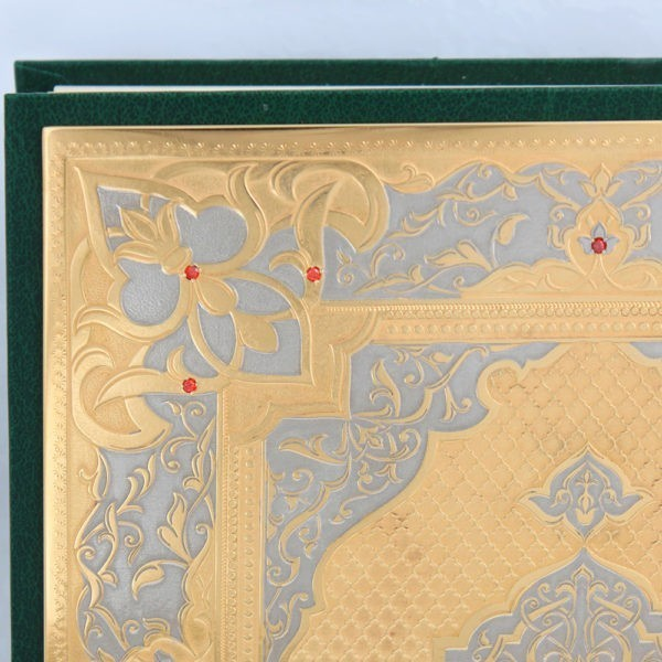 Quran decorated with designer metal plate and stones