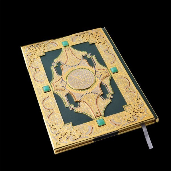 Quran decorated with gold and precious stones.