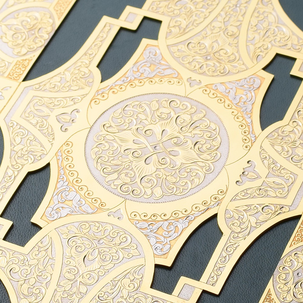 Quran in a metal cover made of gold
