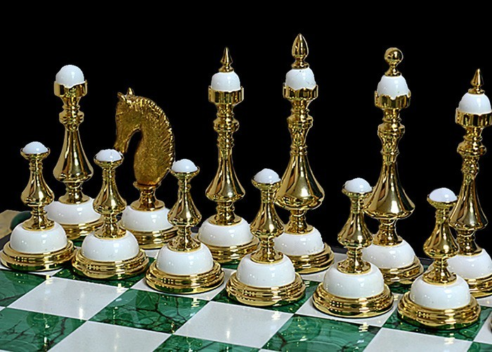 White and green handmade chess made of natural stones