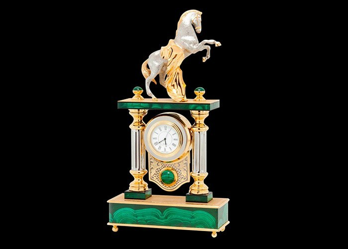 Table clock with a graceful horse