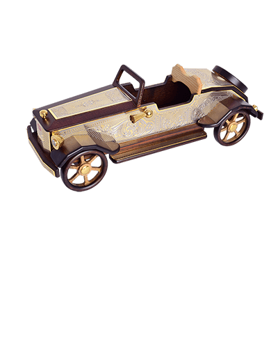 Handmade retro car model made of wood. Decorated with overlays with relief engraving and gilding.