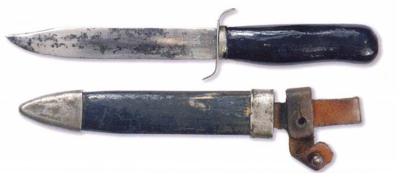 Knife with a different version of the sheath, equipped with a strap for the handle.